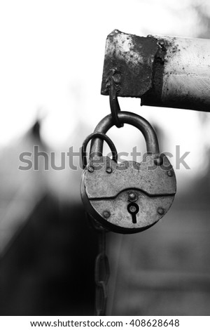 Black and white lock with chain close up - stock photo