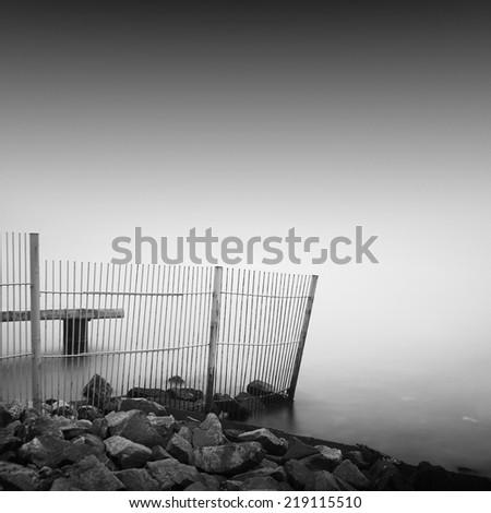 Black and white long exposure shot of stone pier. Odessa, Ukraine - stock photo