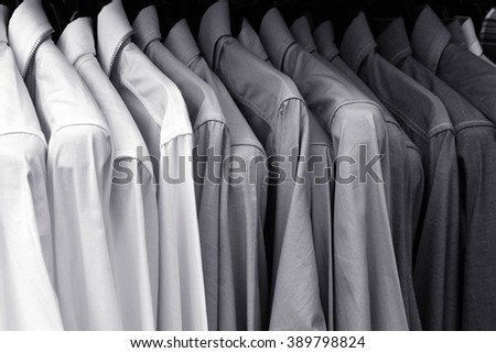 Black and White lot of t-shirt on a hanger - stock photo