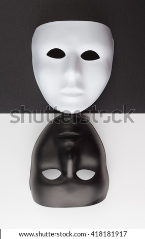 Black and white masks upside down on contrasting backgrounds, Personality change concept