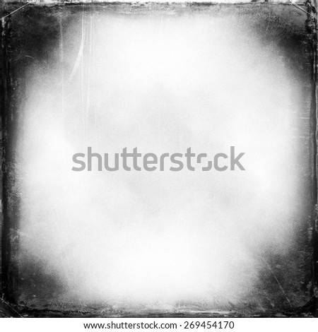 black and white medium format film background with heavy grain and light leak - stock photo