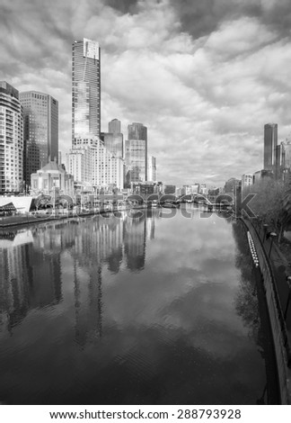 black and white melbourne reflected in the yarra river on a cold winter day - stock photo
