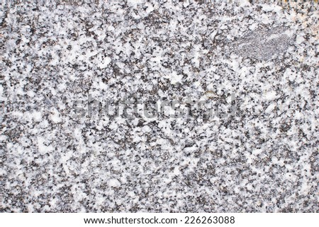 Black and white mineral grain texture. - stock photo