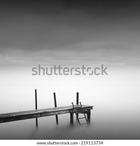 Black and white minimalistic seascape with pier and beautiful sky. Odessa, Ukraine - stock photo