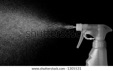 Black and White Mist Spraying from a Spray Bottle - stock photo