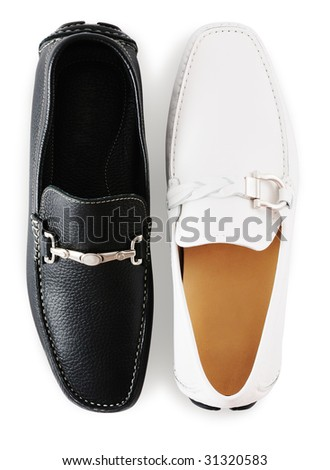 Black and white moccasins isolated against white background - stock photo