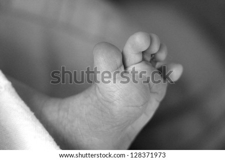 black and white newborn's feet