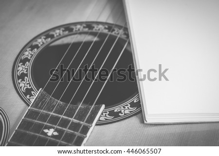 Black and White, Notebook with guitar - Vintage retro picture style, Concept of music
