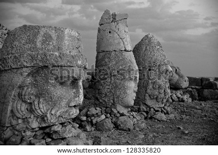 Black and white of God's stone faces, in Nemrut Dagi, Turkey. - stock photo