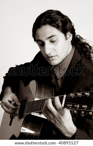 black and white of man playing a guitar