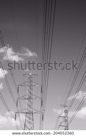 Black and white of power transmission lines/ Power transmission lines - stock photo