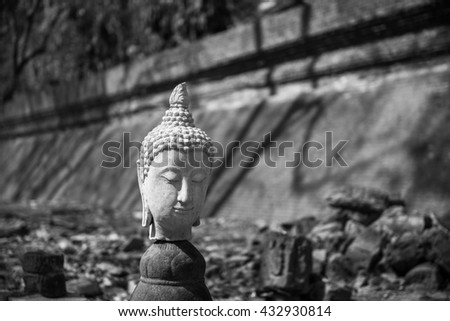 black and white of Sculpture of Stone Buddha in Wat U-mong (U-mong temple), an ancient temple in Chiang Mai, Thailand. - stock photo