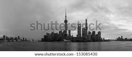 Black and white of Shanghai skyline at dawn. - stock photo