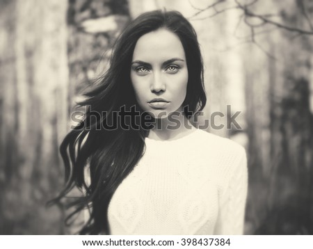 Black and white outdoor fashion photo of young beautiful lady in a birch forest - stock photo