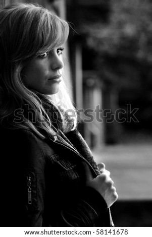 Black And White Outdoor Portrait Of Young Woman - stock photo