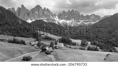 Black and white panorama of Santa Maddalena village with Geisler mountains in the background, Val di Funes, South Tyrol, IItaly, Europe.