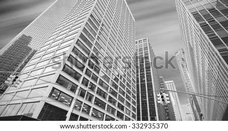 Black and white panoramic picture of modern buildings in Manhattan, New York City, USA. - stock photo