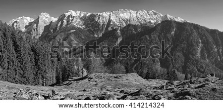 """Black and white panoramic view to the snowy mountains called """"Wilder Kaiser"""" in Tyrol, Austria - stock photo"""