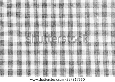 Black and white patterned square fabric. - stock photo