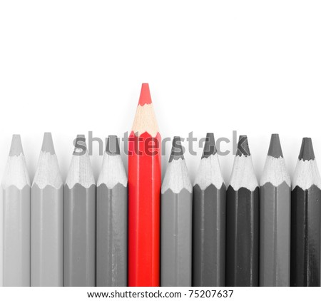 Black and white pencils with on red pencil isolated - stock photo