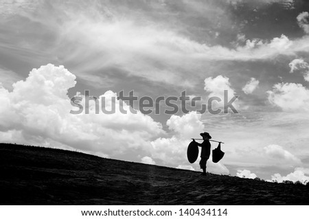 Black and white, people carrying things.