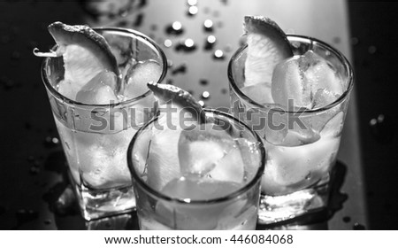 black and white photo. Closeup vodka in a glass with ice, lime.  Gin, tonic, tequila - stock photo