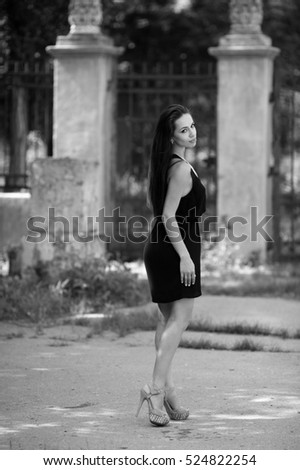 Black and white photo girl with chic long hair and beautiful figure poses