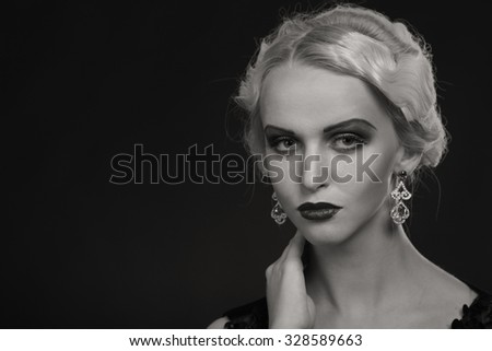 Black and white photo model in a gentle way. Elegant dress and accessories. Professional makeup. Photo for fashion magazines and websites.