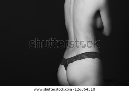 black and white photo of a girl in panties - stock photo