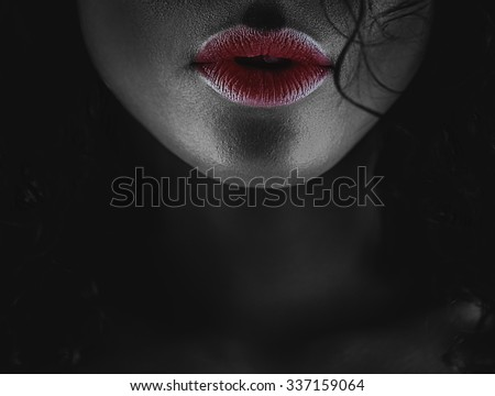 Black and white photo of a girl with red lips