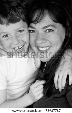 Black and white photo of a happy mother and son