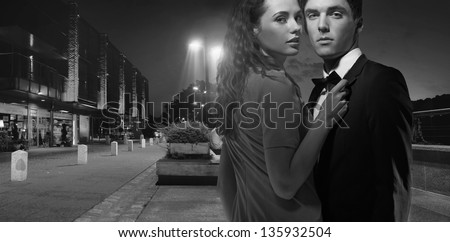 Black and white photo of a sexy couple - stock photo