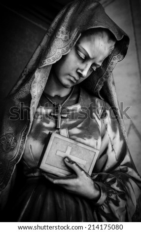 Black and white photo of a tombstone statue on Staglieno cemetery, Genoa, Italy - stock photo