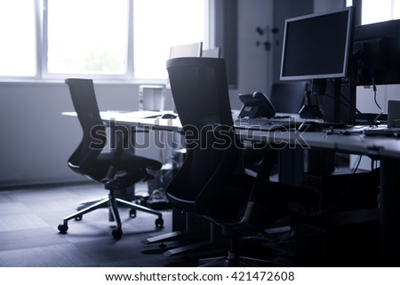 Black and white photo of an empty office in the morning. - stock photo