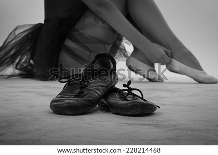 Black and white photo of ballet shoes - dramatic photo - stock photo