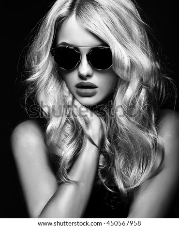 black and white photo of beautiful cute blonde woman girl in sunglasses - stock photo