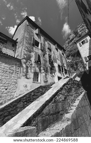 Black and white photo of big stairway at old city with narrow streets