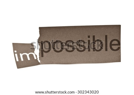 Black and white photo of Changing word impossible to possible. Concepts of problem solving and overcoming challenges.  - stock photo