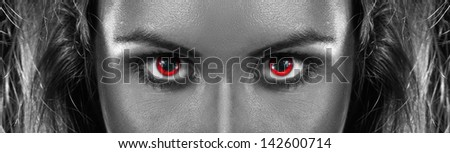 black and white photo of girl with red eyes in studio - stock photo
