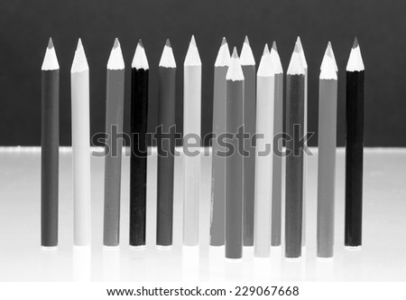 Black and white photo of group of sharp colored pencils