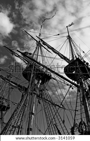 Black and white photo of old ship masts from below.