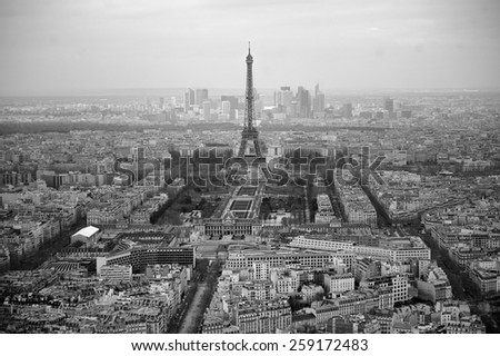 Black and white photo of Paris, France. Aerial view on the Eiffel Tower, Arc de Triomphe, Les Invalides etc.