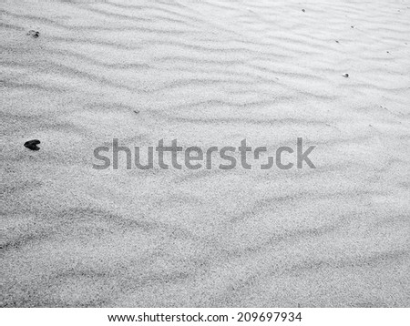Black and white photo of sand dune ripples - stock photo
