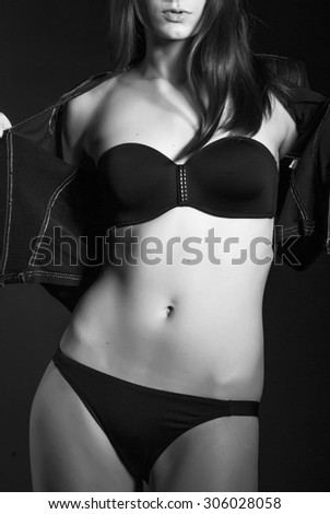 Black and white photo of sexy girls in lingerie on black background