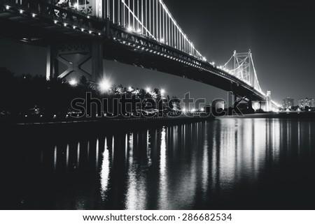 Black and white photo of the Benjamin Franklin Bridge at night, in Philadelphia, Pennsylvania. - stock photo