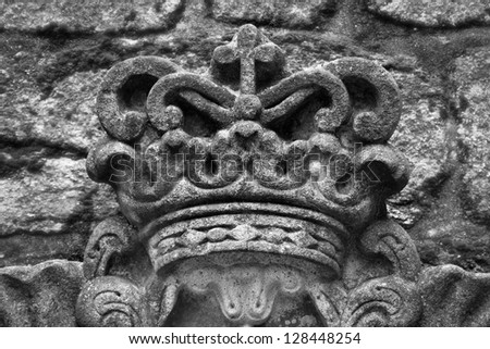 Black and white photo of the crown from stones - stock photo