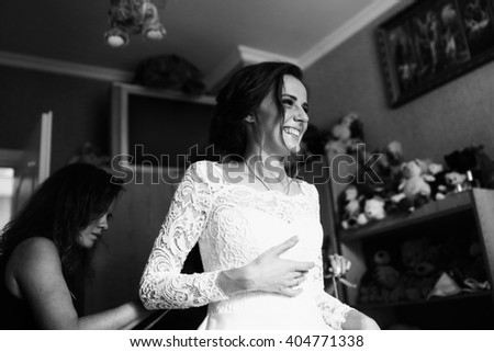 Black and white photo of the preparation of the bride