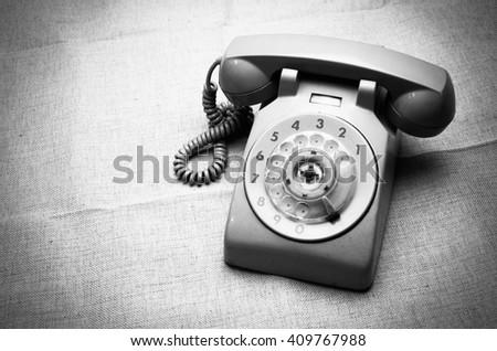 Black and white photo of vintage telephone - stock photo