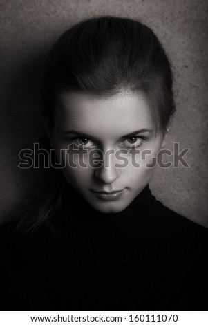 Black and white photo portrait of a girl who looks at the camera with the hope. - stock photo