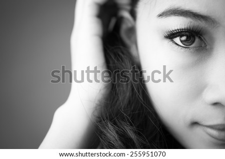 Black and white photo portrait of woman looks at the camera